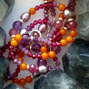 gemstones strung to necklaces and bracelets