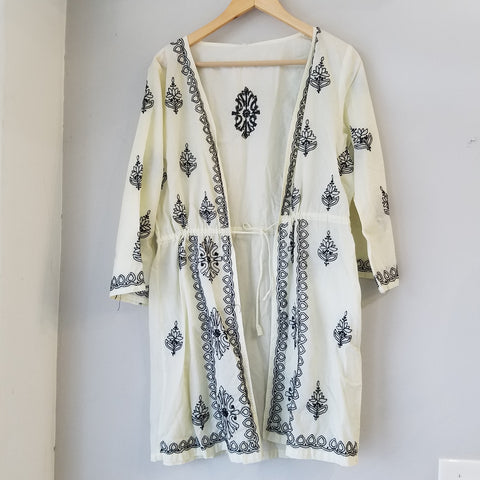 Black embroidery on ivory color tunic