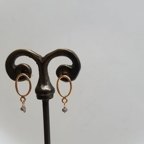 Golden pair of posts/hoops earrings