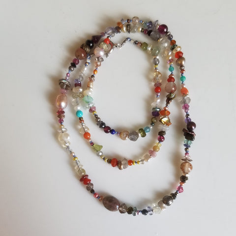 Pearls and gems necklace