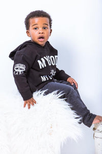 MODEL IS WEARING THE BLACK NIGHT SIDE SEAM HOODED SWEATSHIRT IN SIZE 2/3T *THESE ARE THE RABBIT SKIN 2T