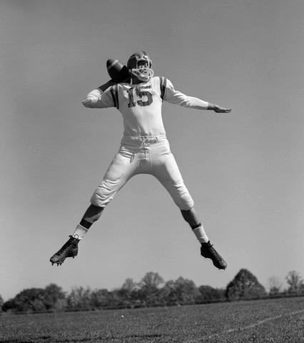 1960s Quarterback Jumping and Sports Wall Mural