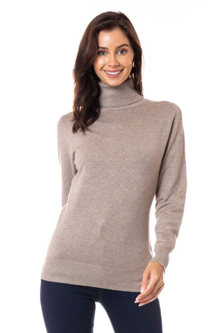 Camel, Semi-Fitted Turtle Neck Sweater  This Semi-Fitted Turtle Neck Sweater is ideal when you need the extra warmth! Ribbed turtle neck, cuffs, and hem. Pair it with your favorite skirt or slacks for work, or pair it with your favorite jeans, vest, and boots for casual wear. 81% Cotton, 16% Nylon, 3% Spandex