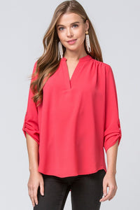 Office to Evening Top, Berry. This top is perfect to transition from work to play without a wardrobe change! It features a V-Neck, 3/4 sleeves with button detail slouchy closures, it is a lightweight woven material that is semi-sheer with no stretch. 100% Polyester.  Pairs nicely with Jeans, Jeggings, Slacks and Skirts. Made in the USA.