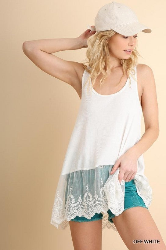 Off White, Ribbed Tank with Lace Trim  This Tank is perfect to layer with cardigans, jean jackets, use as a t-shirt extender or on it's own! It pairs nicely with jean, jeggings, and shorts. 65% Polyester, 35% Rayon.