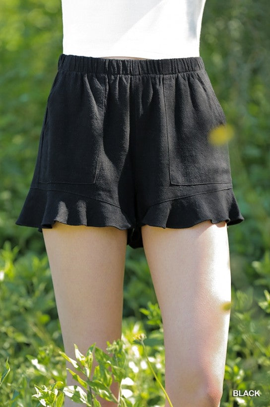 Black, High Waist Shorts  These shorts are a linen blend featuring a high waist, ruffle trim, pockets, and an elastic waist. These shorts are stylish, and pair nicely with all the tops! They look lovely paired with Jean Jackets too! 55% Linen, 45% Cotton