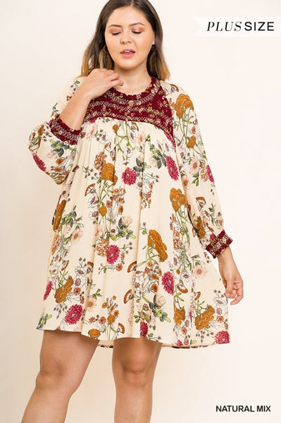 Natural Mix, Smocked High Neck Dress, Women's Plus, Nikki  Our Nikki Dress has a smocked high neck, puff sleeves, and pockets in a lovely floral print material. Pairs nicely with Sandal, Boots, Booties, and Jeggings.  General Size Guide is Women's Plus Contemporary: