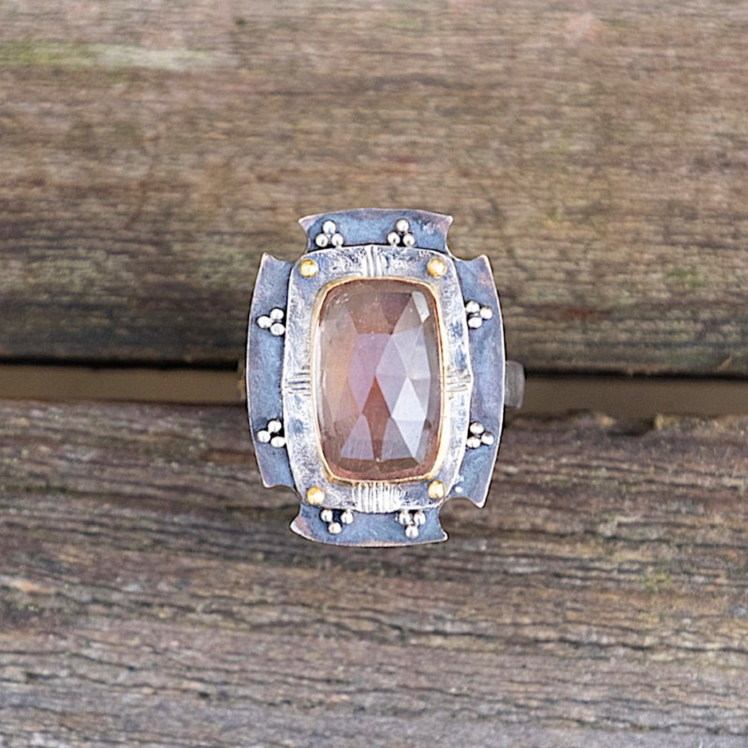 Rose cut Oregon sunstone shield ring with high carat gold and oxidized silver