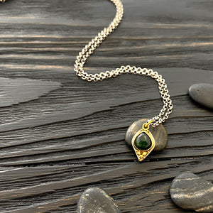 19k gold and silver Etruscan style 'a grappolo' charm necklace with dark green tourmaline