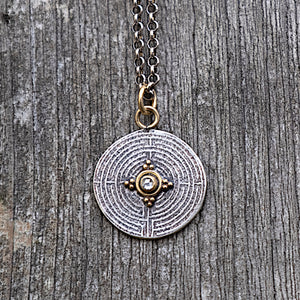 18k gold and silver labyrinth charm necklace with 2mm rose cut diamond and gold granulation
