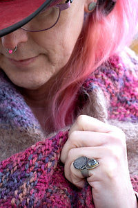 Model wearing rose cut quartz evil eye shield ring with 22k gold and blackened silver