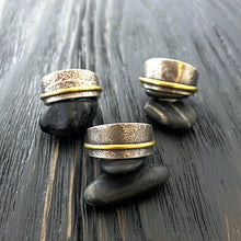 Load image into Gallery viewer, 19k gold and Argentium silver textured unisex band rings in different patterns. group shot