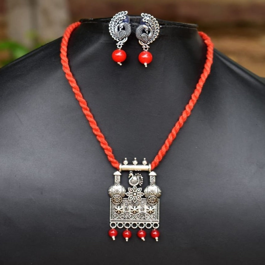 Red Thread Oxidized Peacock Pendant Set With Button Earrings - Phulari