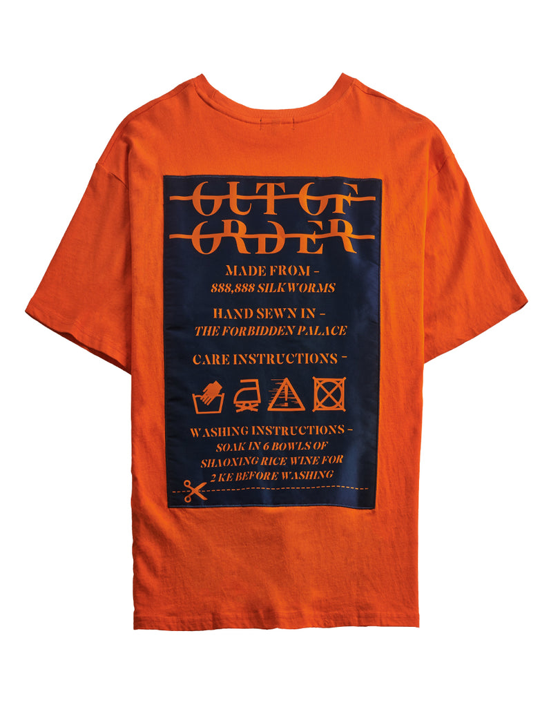 """WASHING INSTRUCTIONS"" ORANGE TEE"
