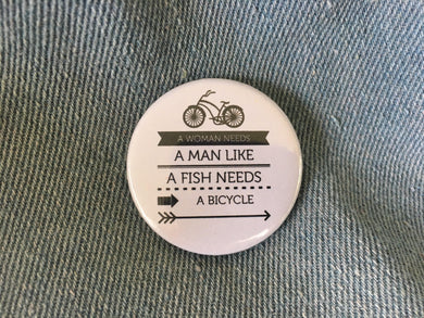 a woman needs a man like a fish needs a bicycle, gloria steinem, feminist pin, feminist button, 1.5 inch pin back button,