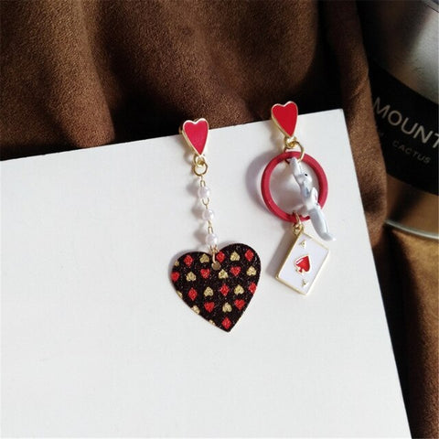 Asymmetric pair of heart earrings
