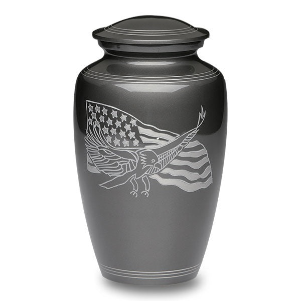 Patriotic cremation urn is made of an affordable alloy and finished in rich gun metal color.