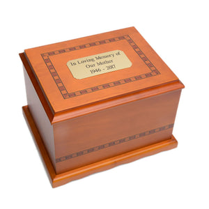 solid birch wood urn in amber finish with hand-painted Inlay design. Comes with black felt lined interior.Wooden cremation urn made of solid birch with hand-painted inlay. Large size. Outer dim: 9.5? L x 7.75 W x 6.125? H, Capacity 200 Cubic Inches.