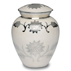 Cremation urns with flowers. Made with white enamel over nickel plated brass, and hand-tooled flower design.