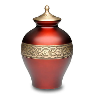 Red cremation urn made in solid brass. Large memorial urn for ashes.