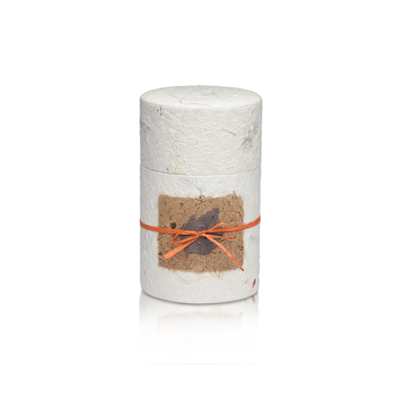 Oval shaped biodegradable cremation urn in white made of hand-crafted papers and available in four sizes.