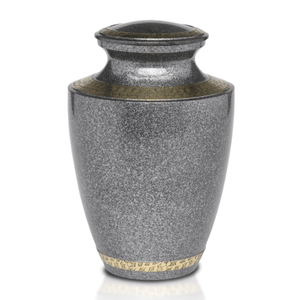 Black Speckle brass cremation urn with hand-tooled brass design band. Threaded lid allows secure closure. Felt-lined base.