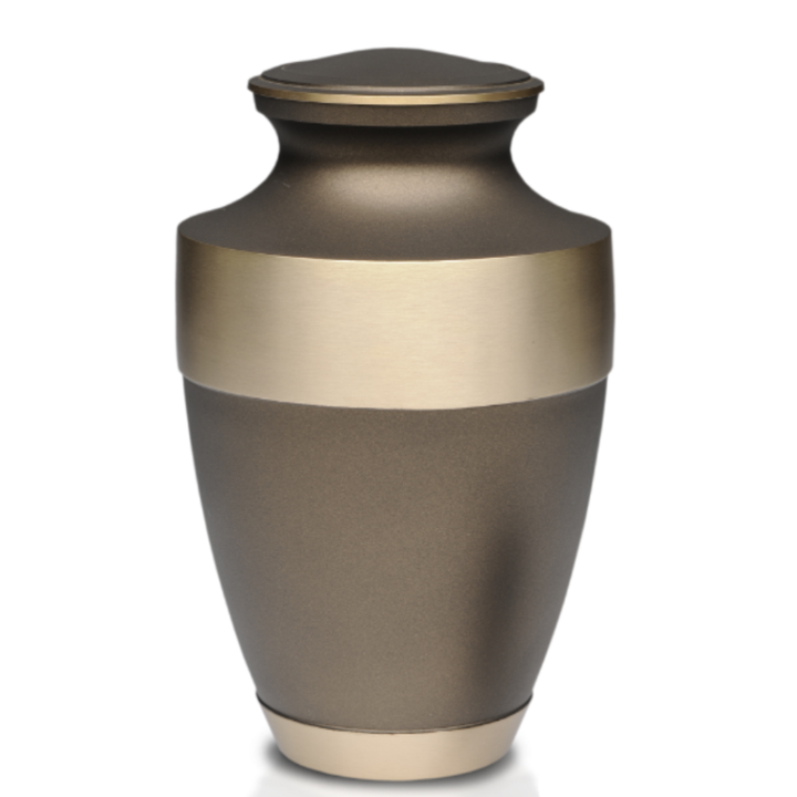 Cremation Urn in Beautiful Rustic Bronze Finish with a 2″ Engravable Brass Band. Threaded lid allows secure closure. Felt-lined base.