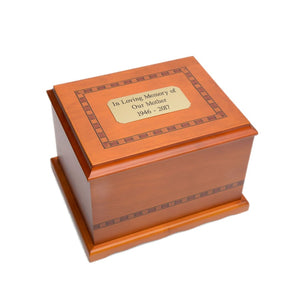 solid birch wood urn in amber finish with hand-painted Inlay design. Comes with black felt lined interior.Wooden cremation urn made of solid birch wood. Large size urn.Outer dim:  9.5? L x 7.75 W x 6.125? H, Capacity 200 Cubic Inches.