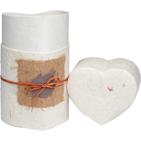 Biodegradable cremation urn made of handmade paper with leaf design in heart shape form.