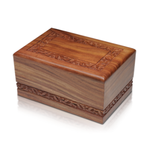 Wooden cremation urn made of solid rosewood with hand-carved border. Easy financing options. Free ground shipping