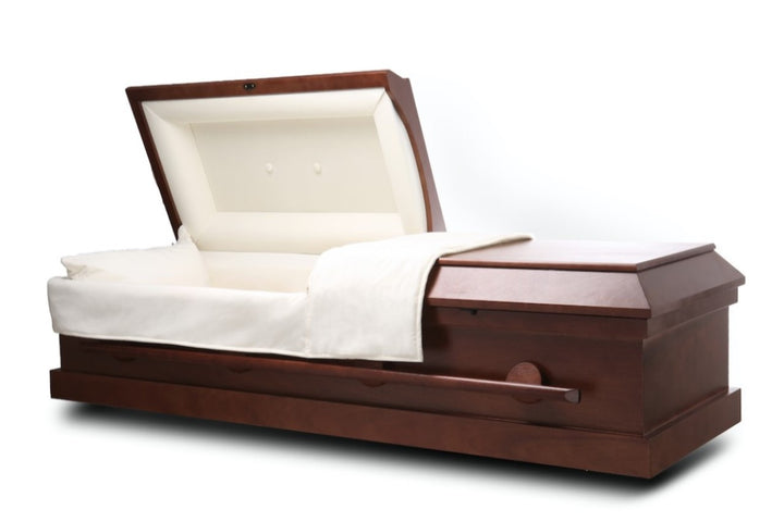 teak wood cremation casket is handmade of durable wood veneer that's polished to a matte finish. The interior comes with plush ivory velvet lining and soft matching pillow.