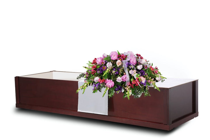 Simple, yet dignified wooden veneer cremation casket priced under $500 that's handcrafted and polished to a matte teak finish. The interior is white satin lined.