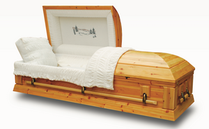 Solid wood casket in Cedar handmade and polished to a matte clear finish. All hardware fittings are bronze.  The interior is complimented with fine ivory velvet lining and matching pillow.