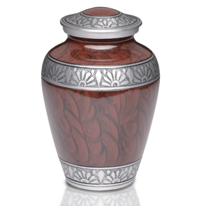 Alloy Cremation Urn with Espresso Brown hand feathered design and Hand-Tooled Pewter Band. Threaded lid allows secure closure. Felt-lined base.