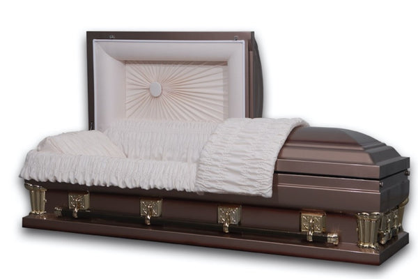 Oversize casket in 18 gauge steel deluxe copper finish and lined ivory velvet.
