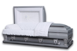Oversized casket in silver made of 18 gauge steel, and lined in ivory velvet.