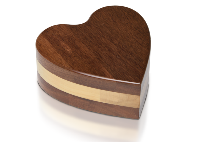 solid acacia wood heart-shaped cremation urns are beautifully crafted, and perfect for use as a pet urn, child urn, or as a keepsake. Dimensions: 7″ L x 7″ W x 2.75″ H Capacity: 50 Cubic Inches or 3.5 cups of ash.
