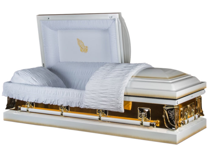 White and gold casket made of 18 gauge steel, and lined in plush white velvet.