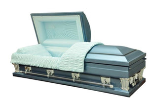 Oversized casket in blue made of 18 gauge steel, and lined in ivory velvet.