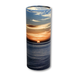 "Token keepsake scatter tube with Ocean Sunset design. Dimensions 4.75"" * 2"" and Capacity: 10 cubic inches."