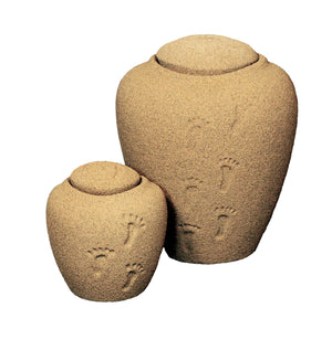Sand with foot print cremation urn made of sustainable materials and kiln-fired for strength & durability and are ideal for presentation in home or cemetery niche available in adult and mini sizes.