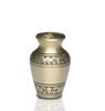 Brushed Brass Cremation Urn with Hand-engraved Design. Threaded lid allows secure closure. Felt-lined base.