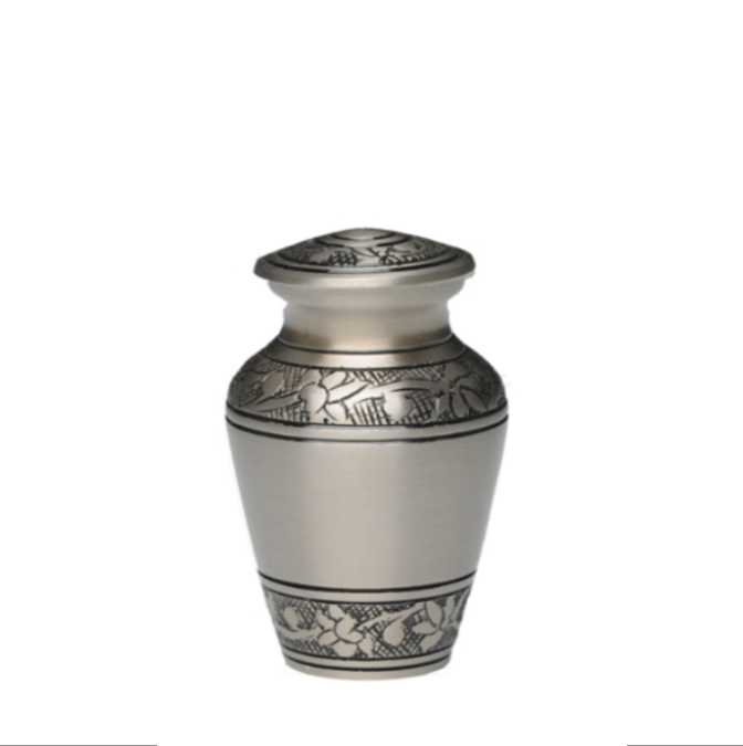 Brushed Pewter Cremation Urn with Hand-engraved Design. Threaded lid allows secure closure. Felt-lined base.