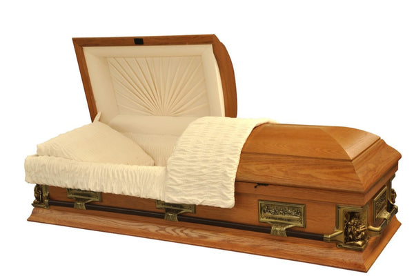 Oak Wood Veneer Casket Pieta Oak Model is handmade and polished to a matte finish and adorned with bronze steel hardware and Last Supper accents. The interior is beautifully lined in ivory velvet.