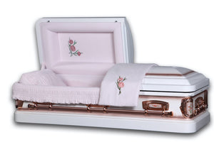 White casket made of 18 gauge steel with antique finish, and lined with pink velvet.
