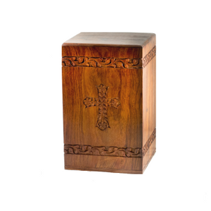 Rosewood cremation urn with hand-carved cross design urn for ashes.
