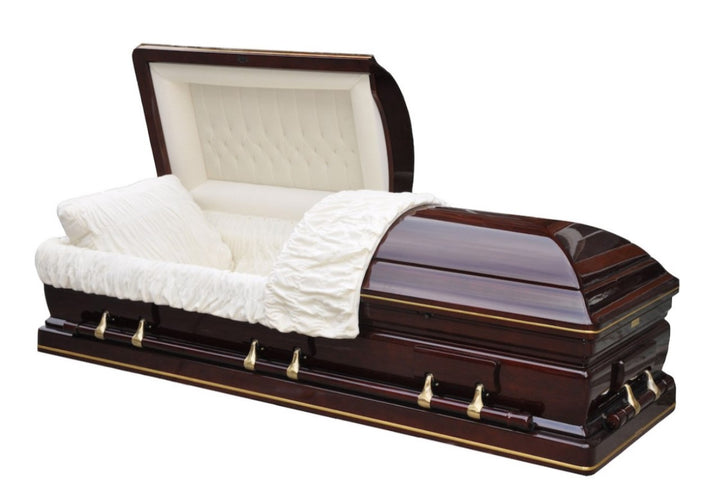 Solid Elm Wood Casket is adorned with gold trim and polished to a cherry finish; accompanied with high-grade bronze hardware fittings and plush beige velvet interior.