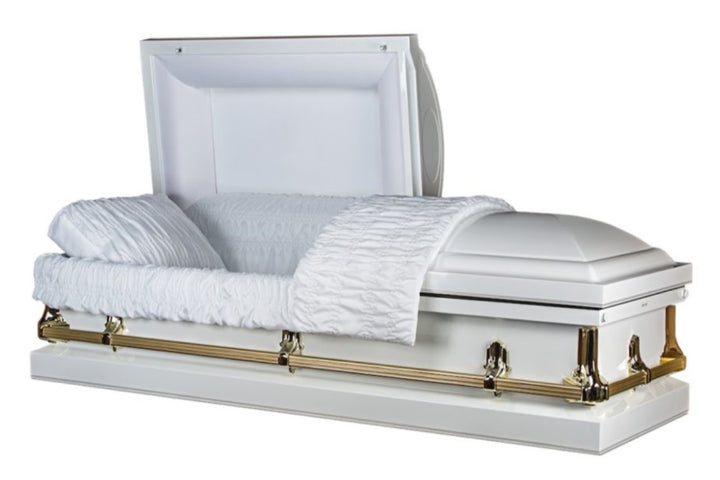 White and gold casket made of 20 gauge steel, lined in plush white velvet.