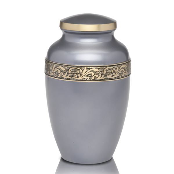 Adult Brass Cremation Urn with Beautiful Metallic Silver Finish and Design Hand-Tooled Antiqued Brass Band. Threaded lid allows secure closure. Felt-lined base.