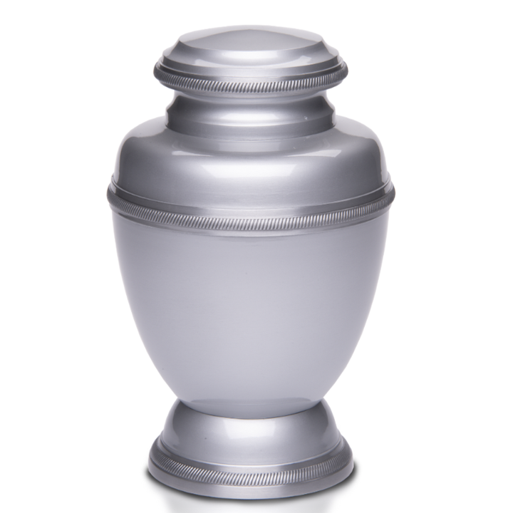 Cremation Silver Color Urn with Hand-tooled rope edging detail.  Threaded lid allows secure closure. Felt-lined base.